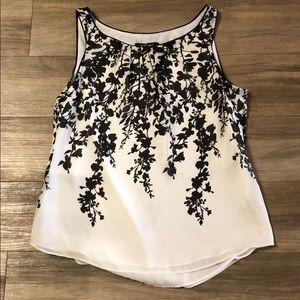 White House Black Market floral shell blouse.